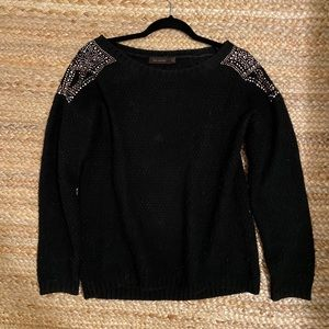The limited loose fit black gem encrusted sweater